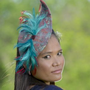 aqua and red fascinator with feathers and beading
