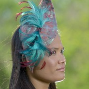 red and blue fascinator cocktail hat with teal and red feathers