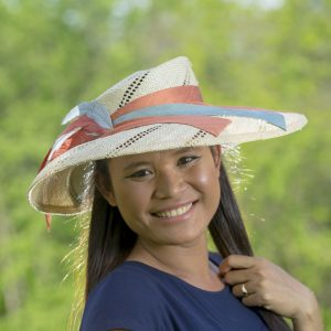 wide-brim, natural straw portrait hat with silk and feathers