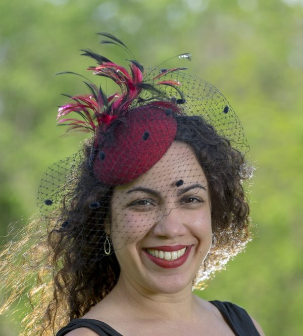 Red fascinator, black netting and black and red feathers