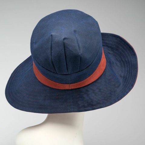 wide-brimmed cloche, blue and red waxed cotton