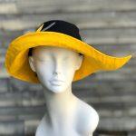 Yellow and black soigné rain hat