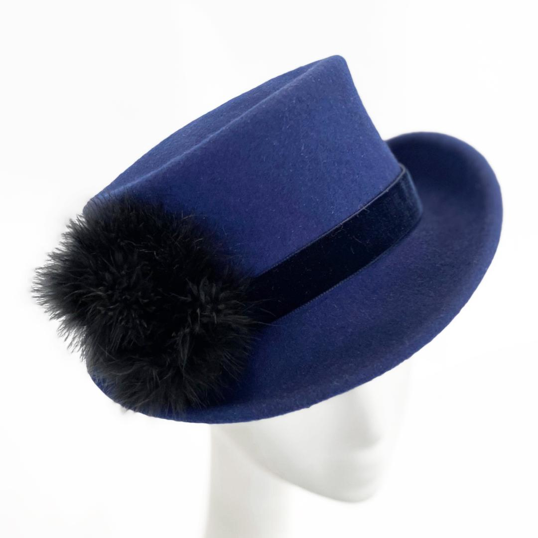 Cobalt blue top hat with black down feathers