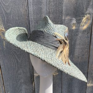 Front view of asymmetrical straw hat
