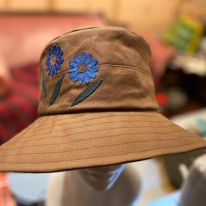 Wide-brimmed rain or shine hat