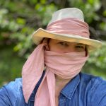 Vanilla fedora with pink scarf