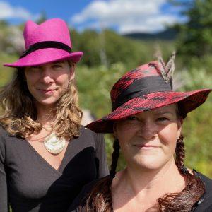 Two women wearing hats.