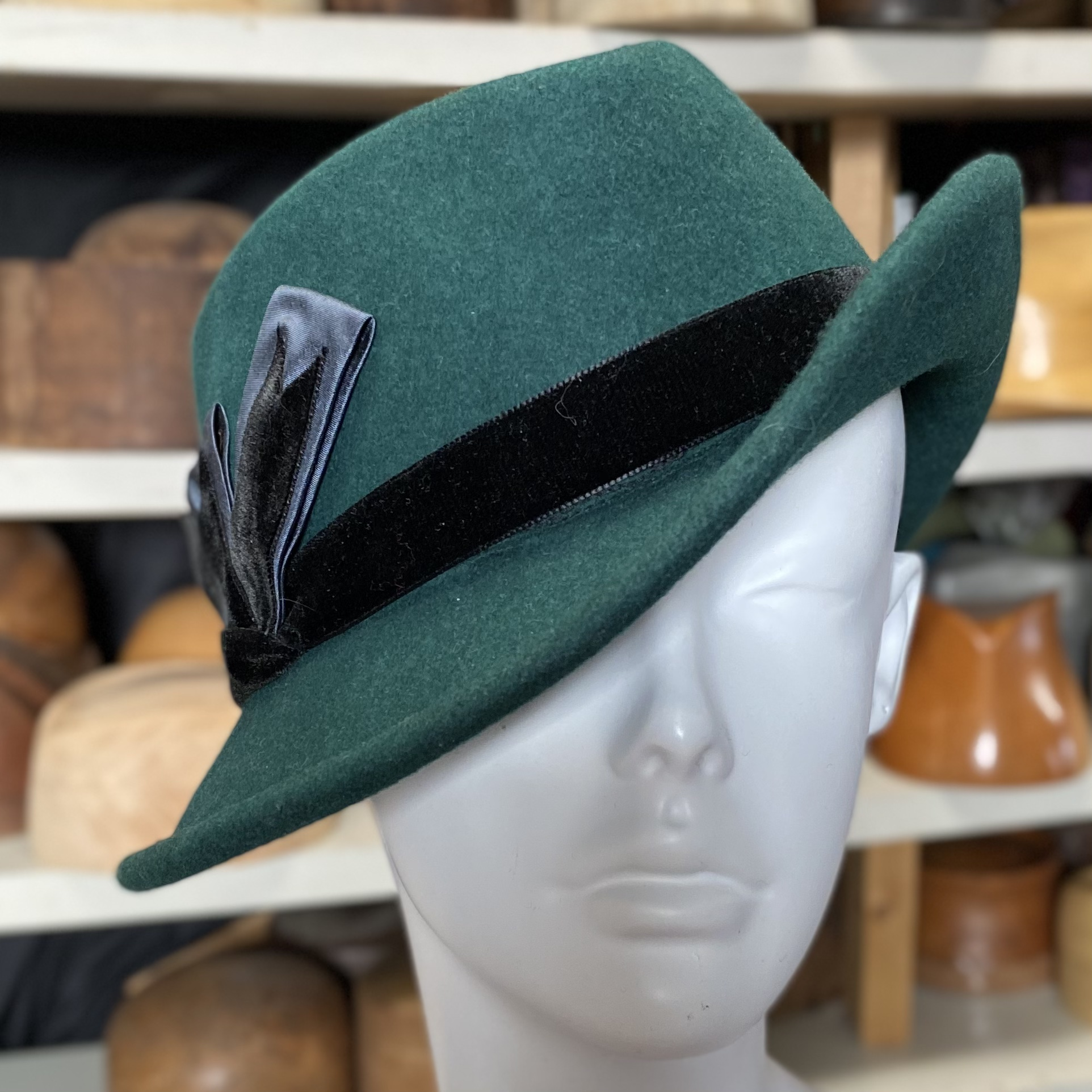 A ladies green wool felt fedora hat.